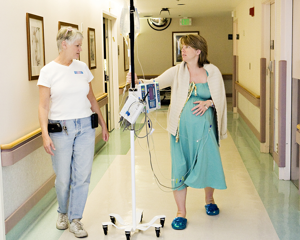 doula walking with client #341 during early labor
